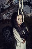 stock photo of gallows  - Sad angel with black wings and gallows
