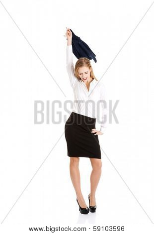 Beautiful caucasain business woman takes off her jacket. Seems to be happy. Isolated on white.