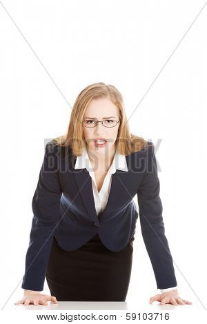 Angry and furious business woman. Isolated on white.