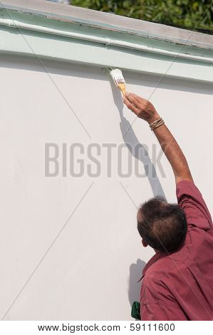 Male Painting The Wall.