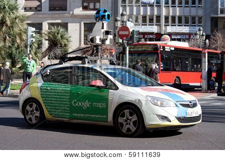 VALENCIA, SPAIN - JANUARY 27, 2014: A Google Street View vehicle used for mapping streets throughout the world drives through the city center of Valencia. Google Street View started in May 2007.