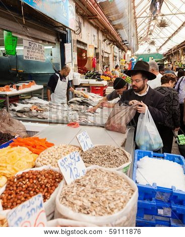 Jerusalem, Israel - November 15, 2012 - people are shopping at Mahane Yehuda - famous market in Jerusalem
