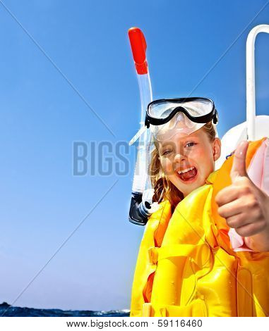 Happy  child on yacht thumb up. Snorkeling travel.