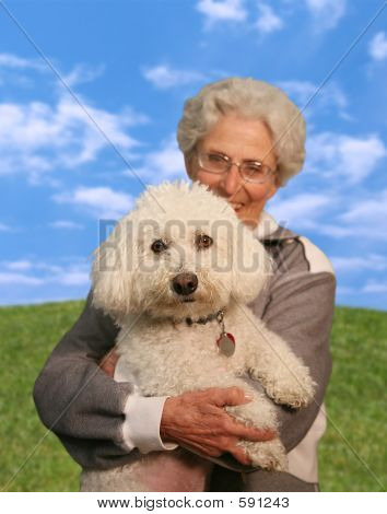 Woman Holding Dog (Focus On Dog)