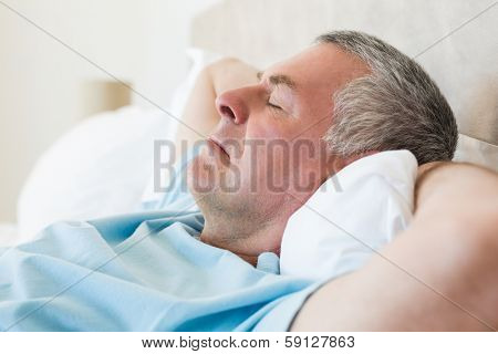 Closeup of senior man sleeping in bed at home