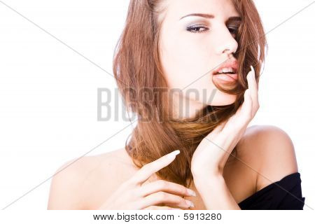 sensual young woman with long hair over her neck and nacked shoulders