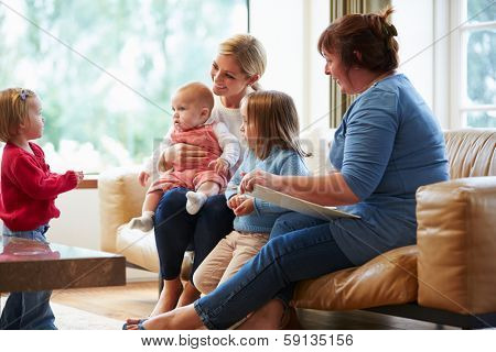 Health Visitor Talking To Mother With Young Children