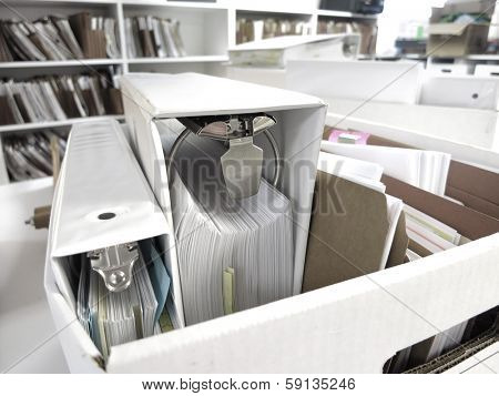 Box of binders and files stored in business office
