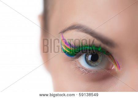 Gray-eyed girl with bright make-up, close-up