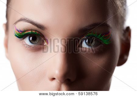 Eyes of young girl with bright makeup, close-up