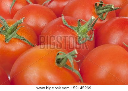 Bunch Of Tomatoes Alongside