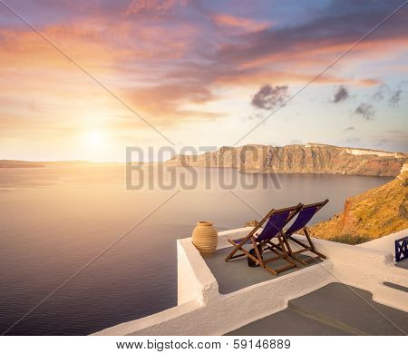 Santorini balconny with view at the Aegean sea at sunset