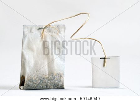 Teabag with white label. Isolated on white background.