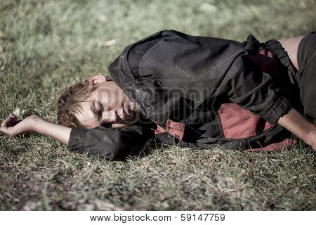 young homeless man sleeping