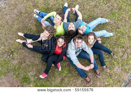 Highschool students sitting in park shot from above