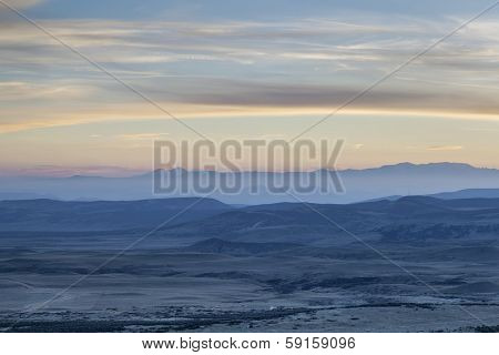 dusk over prairie, foothills and Rocky Mountains - looking west from Soapstone Praiire Natural Area, Colorado