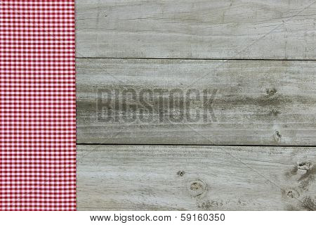 Red gingham border with wood background