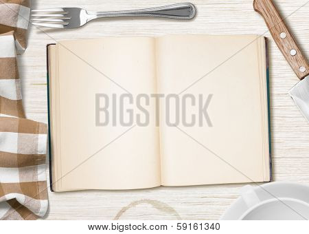kitchen table with open book or copybook as a background for cooking recipe