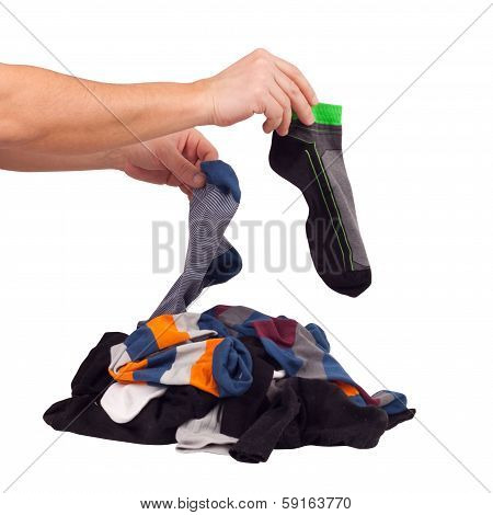 Choose of pile unsorted socks. Isolated