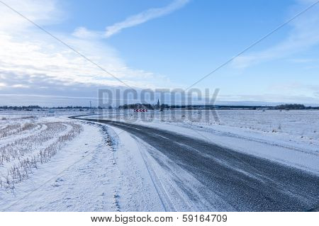 Countryside Road Through Winter Field