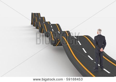 Rear view of mature businessman posing against bumpy road background