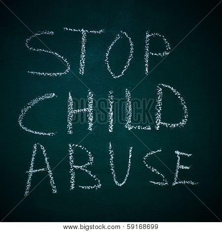 sentence stop child abuse written in a chalkboard