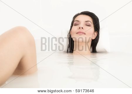 Blissful Woman Soaking In A Hot Bath