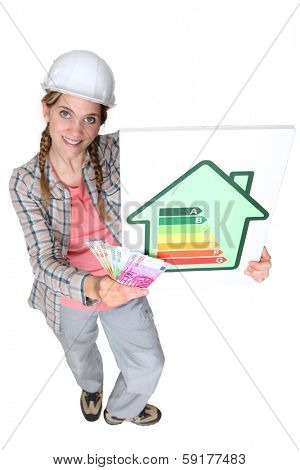 craftswoman holding energy consumption label