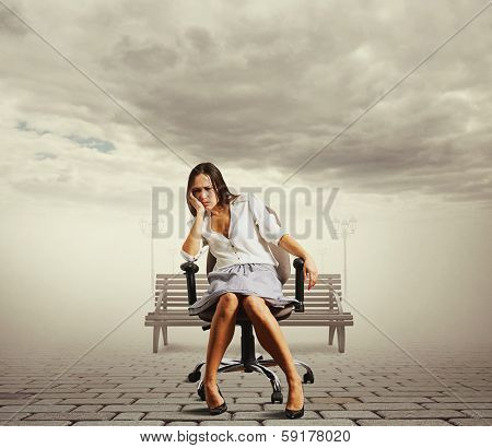 tired young woman sitting on the office chair at outdoor