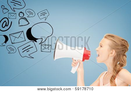communication concept - girl with megaphone over blue background