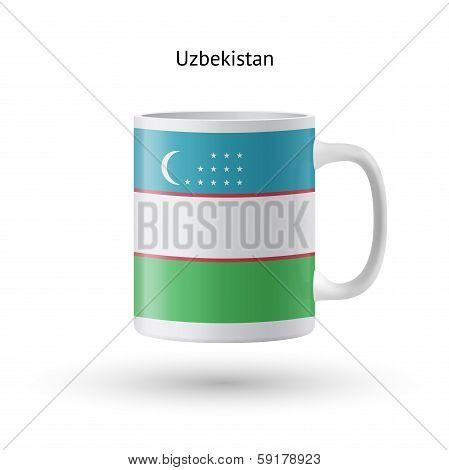 Uzbekistan flag souvenir mug on white background.