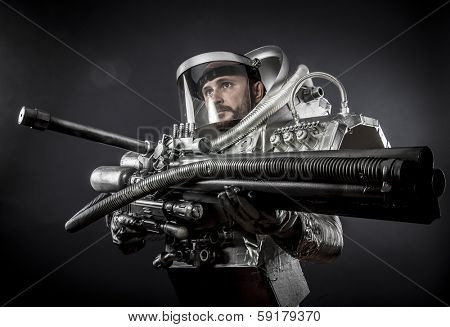 Spacesuit, Astronaut on a black background with huge weapon.