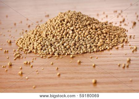 Dry yeast heap in wooden board table