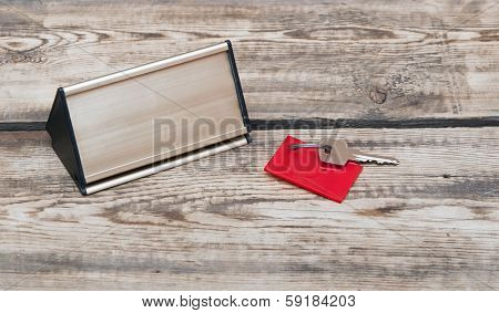 key with blank tag and metal nameplate