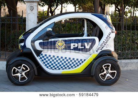 VALENCIA, SPAIN - JANUARY 27, 2014:  A Renault Twizy Electric Police car being used by the Valencia, Spain police. The Twizy was the top-selling plug-in electric vehicle in Europe during 2012.