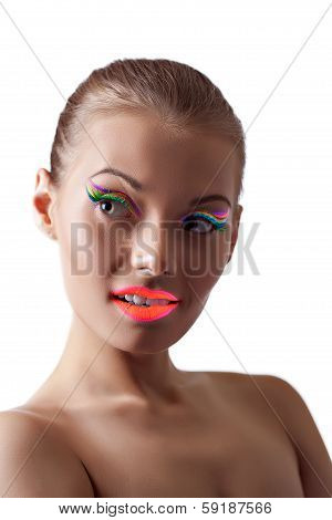 Image of playful young girl with bright UV makeup