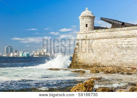 Tower of the castle of El Morro with the Havana skyline clearly visible in the background