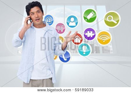 Clueless male on his cellphone against computing application icons