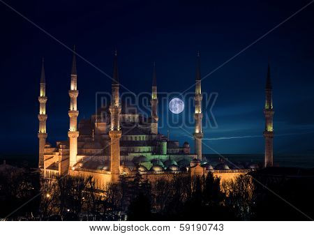 Blue mosque at night with full Moon rising, Istanbul, Turkey