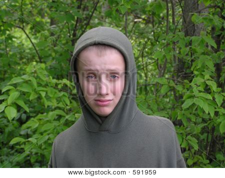 Boy In A Grey Capuche