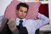 stock photo of table manners  - Businessman sleeping at his office with his shoes on the table - JPG