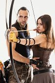 foto of longbow  - Young couple has some dangerous hobby - JPG