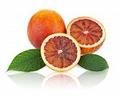 Blood Oranges With Cut And Green Leaves Isolated On White Background.
