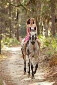 image of bareback  - young woman riding horse bareback in forest - JPG