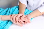 image of sympathy  - Medical doctor holding hand of patient - JPG