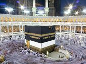 foto of mekah  - Kaaba the Holy mosque in Mecca with Muslim people pilgrims of Hajj praying in crowd  - JPG