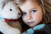 stock photo of bff  - A child wrapped up in blanket with soft toy - JPG