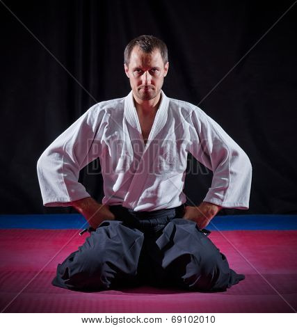 Aikido fighter on black background