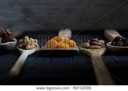 Dried Fruit and Nuts on Wooden Spoons - Selective focus