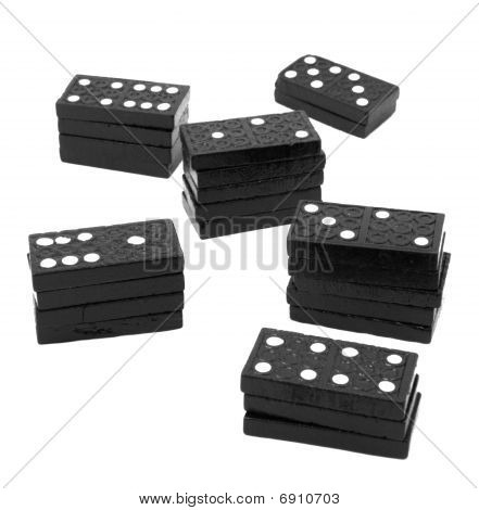 Stacks of black wooden dominos